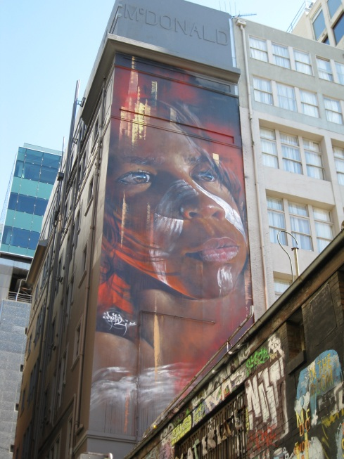 Street art is celebrated in Melbourne. This is a pretty cool painting of an aboriginal girl.