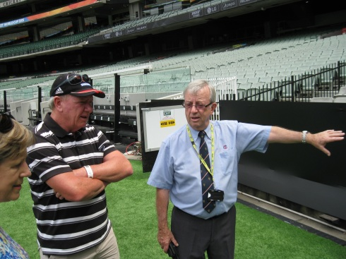 On the right is Brian, our guide for the tour of the Melbourne Cricket Grounds. We were down on the 'pitch' at that moment.