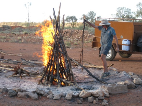 Tom gets the fire going at our fish camp. The dingos were not deterred.