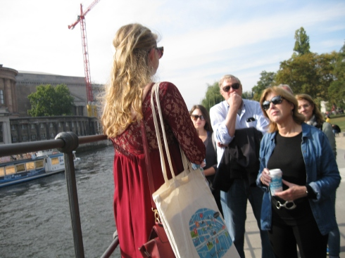 Our tour guide gives us Berlin history lesson as we stand over the river Spree.