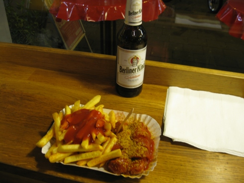 For the equivalent of $5 U.S., you get currywurst, fries and a beer.