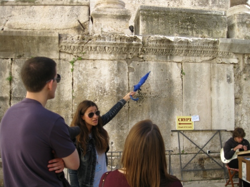 Lucy, the guide for our walking tour, is a Split native. If you look up above where she's pointing, you can see a Roman cross on one of the sarcophagi.