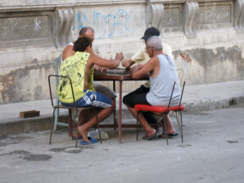 Men playing dominoes on a street in Centro Havana. They were super fast.