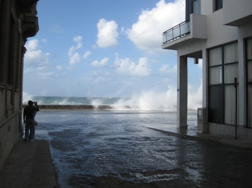 The water began to flood past the Malecon.