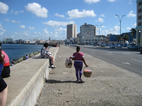 Food seller walking along the Malecon in Havana.