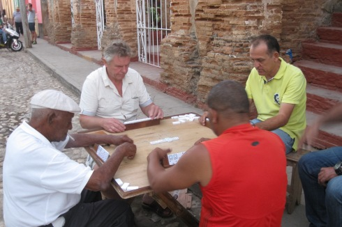 Men playing dominoes on a street in Trinidad. They were very serious.